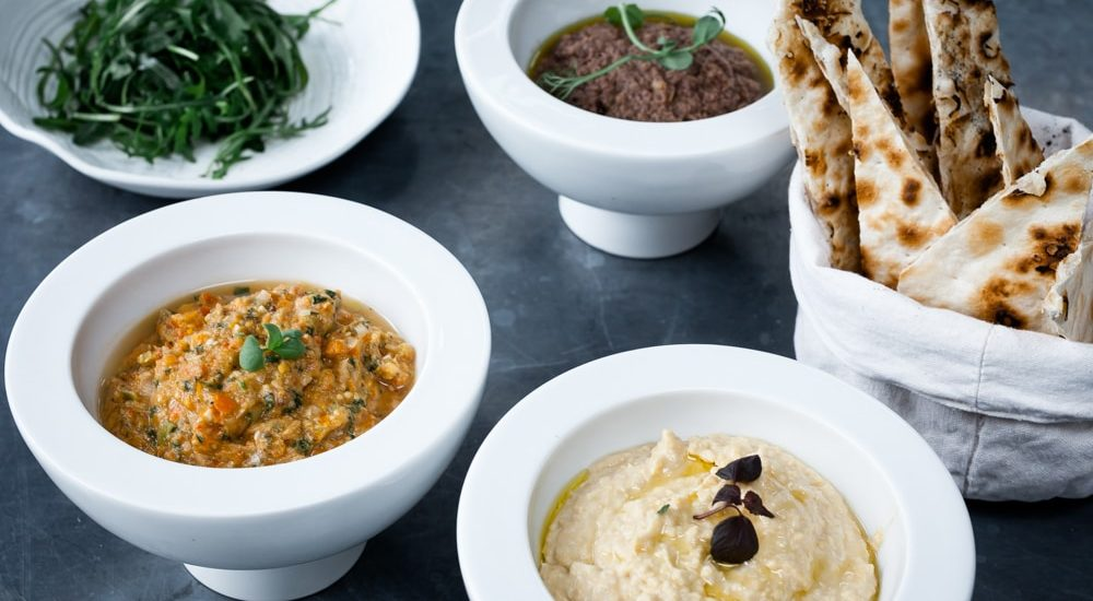 humus, tomato dip and tapenade on Amelie Restaurant Menu