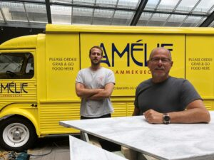 Alex and Regis Crepy in front of the Restaurant Van serving flammekueche
