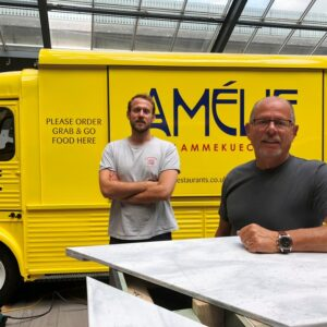 Alex and Regis Crepy in front of Amelie's Van serving flammekueches