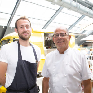 Alex and Regis Crepy in front of Amelie Restaurant' s van