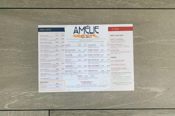 new menu at Amelie Restaurant featuring starters, sides, flammekueches and desserts