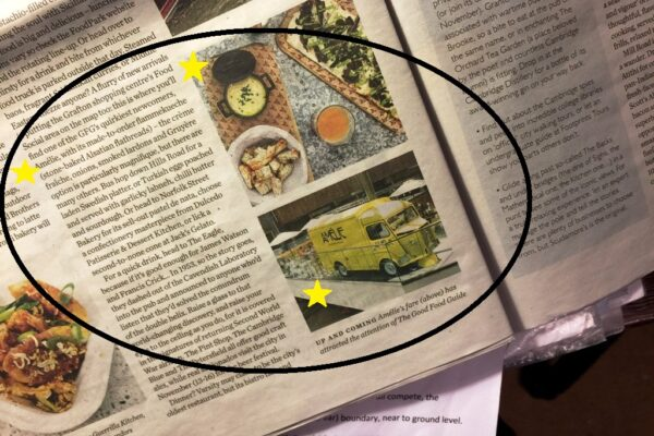 Amelie restaurant is featuring in the Waitrose Weekend Magazine. Article with two pictures, one of the yellow Amelie van and another one with cheese fondue and a flam kuche on a table