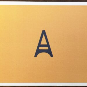 Amelie Gift Voucher with the A capital letter on yellow back ground