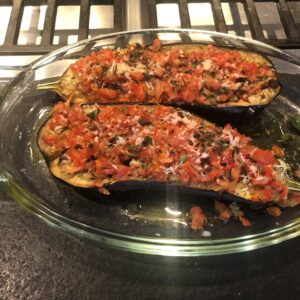Roasted Aubergines topped with tomato and herbs
