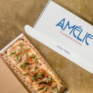 flam-kuche ready to be delivered in the take away box at amelie restaurant