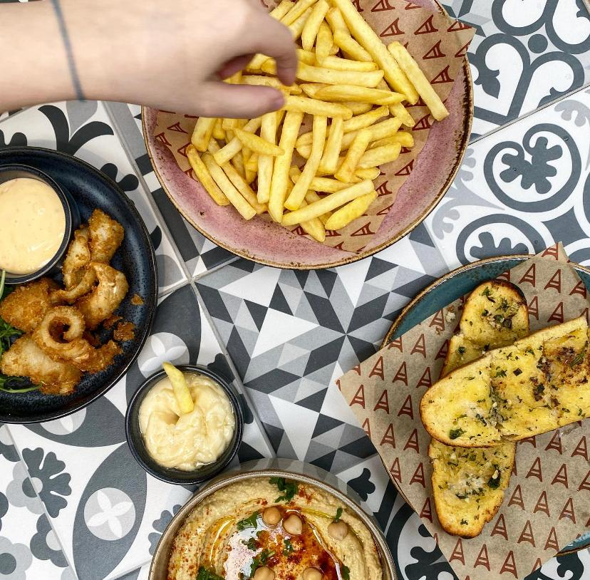 New dishes at Amelie Restaurant: french fries, fried squids, garlic bread  and hummus